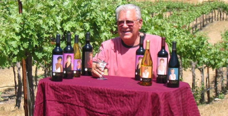 Budge shows off his Cleavage Creek wines amidst his vineyard